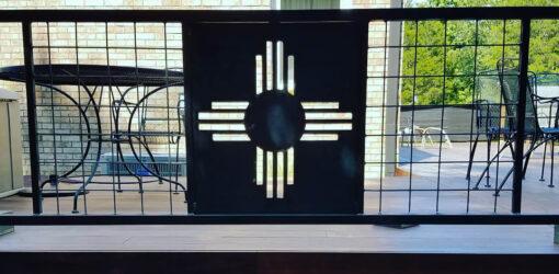 Decorative Sun Design in Metal Deck Railing